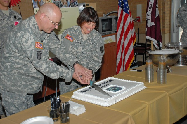 FORT CARSON, Colo.--- Evans Army Community Hospital Command Sgt. Maj. Dennis Wilken and Commander Col. Jimmie Keenan cut the cake recognizing the signing of the Army Healthcare Covenant.