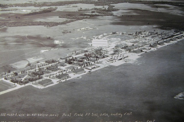 Fort Sill's airfield, and the buildings lining it, looked quite a bit different in this photo from 1935. Aircraft would take off and land in the grass along the right side of the buildings. McNair Hall, which was new at this time, and the Old Post Quadrangle, would be out of frame to the left.