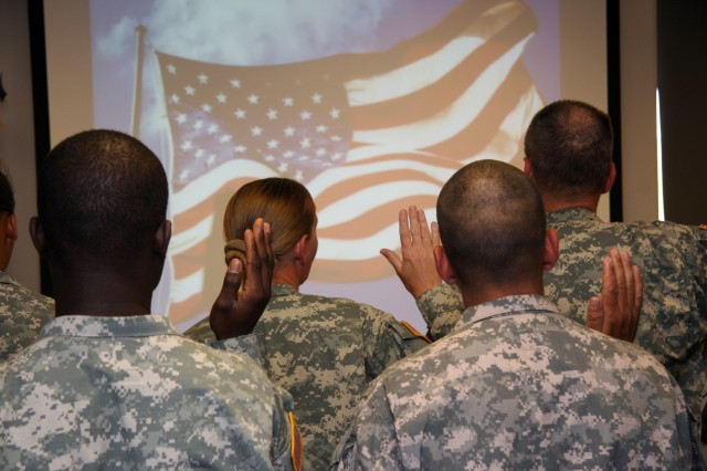 FORT CARSON, Colo.---Fort Carson's newest American citizens take the oath of allegiance to the United States in a naturalization ceremony on Fort Carson May 20.