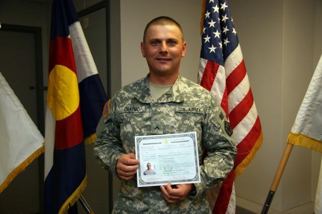 FORT CARSON, Colo.---Pvt. Tudor Craznic, 4th Engineer Battalion, shows off his U.S. citizenship papers following the naturalization ceremony May 20.
