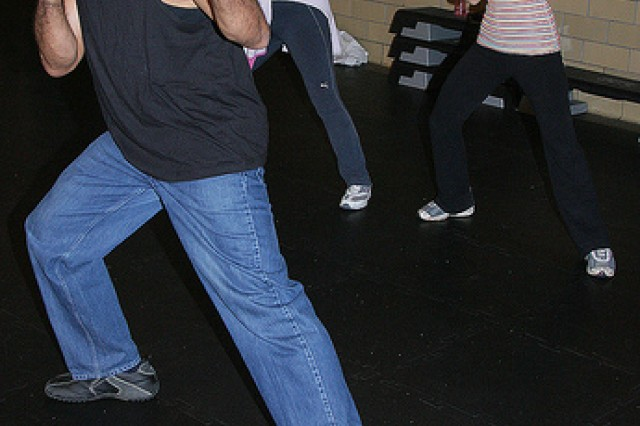 Thomas Felder leads students through a drill during Self-Defense 101 at Honeycutt Fitness Center.