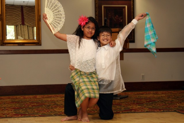FORT CARSON, Colo.--- Annissa Deguzmam and Adrian Fernandez, of the Filipino-American Community of Southern Colorado Unity Friendship Dancers, perform the Carinosa Dance during the Asian/Pacific Islander Heritage Celebration May 24 at the Elkhorn Conference Center.