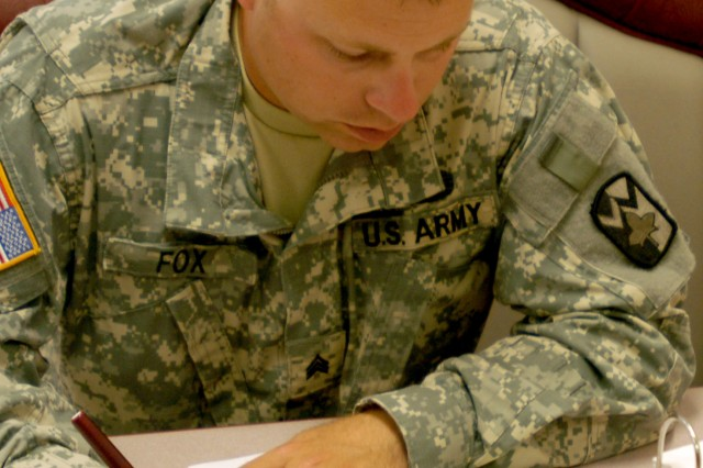 Sgt. Michael Fox, from the 4th Sustainment Brigade, 13th Sustainment Command (Expeditionary), focuses on the first challenge, a 50 question exam, during the Wrangler Brigade Soldier and NCO of the year competition at Fort Hood, Texas May 10. (U.S. Army photo by Sgt. Angiene L. Myers)