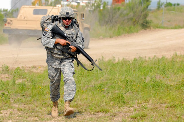 Sgt. Michael Fox, from the 4th Sustainment Brigade, 13th Sustainment Command (Expeditionary), runs to the finish line to wrap up the physical endurance portion of the Wrangler Brigade Soldier and NCO of the year competition at Fort Hood, Texas May 11. (U.S. Army photo by Sgt. Angiene L. Myers)