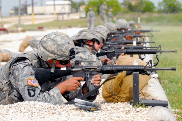 Both Sgt. Michael Fox and Spc. Amber Burkhart, from the 4th Sustainment Brigade, 13th Sustainment Command (Expeditionary), fire their M16A2 semi-automatic weapons during Wrangler Brigade Soldier and NCO of the year competition at Fort Hood, Texas May 11. (U.S. Army photo by Sgt. Angiene L. Myers)
