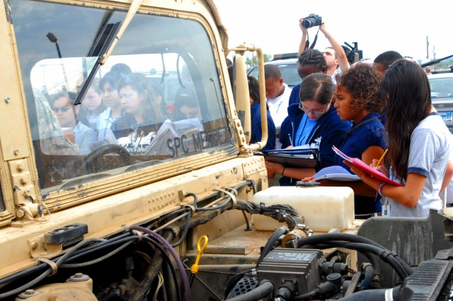 Students at Nolan Middle School in Killeen, Texas had a chance to see first-hand the differences between Humvees as Soldiers, from the 4th Sustainment Brigade, 13th Sustainment Command (Expeditionary), used military equipment to teach math and history as a part of the unit's Adopt-A-School program May 25. (U.S. Army photo by Pfc. Amy M. Lane)