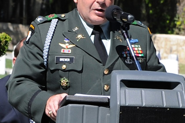 PRESIDIO OF MONTEREY, Calif. - Presidio of Monterey Garrison Commander Col. Darcy Brewer speaks to those in attendance at the POM cemetery rededication ceremony May 29.