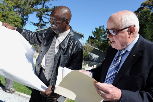 PRESIDIO OF MONTEREY, Calif. - Retired Maj. Gen. Frederick Lawson (right) consults a layout of the cemetery grounds with Tommy Brooks, a member of the Presidio's Directorate of Human Resources, to find familiar graves. Lawson helped rededicate the Presidio of Monterey cemetery May 29.