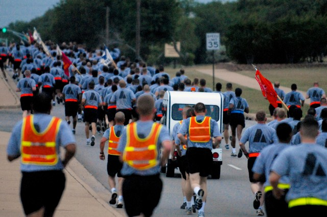 Battalion Avenue on the west side of Fort Hood was overwhelmed with Wrangler Soldiers as the 4th Sustainment Brigade commander led an esprit de corps run May 21. All four battalions in the brigade and more than 3,000 Soldiers ran in the formation to kick off Wrangler Day. (U.S. Army photo by Sgt. Angiene L. Myers)