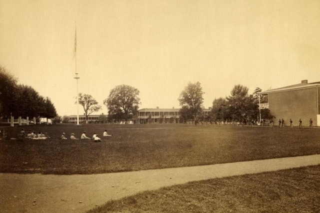 Horse troops! Children watch cavalry troops drill on the parade ground at Carlisle Barracks, circa 1838-1871. (Carlisle Barracks Collection).