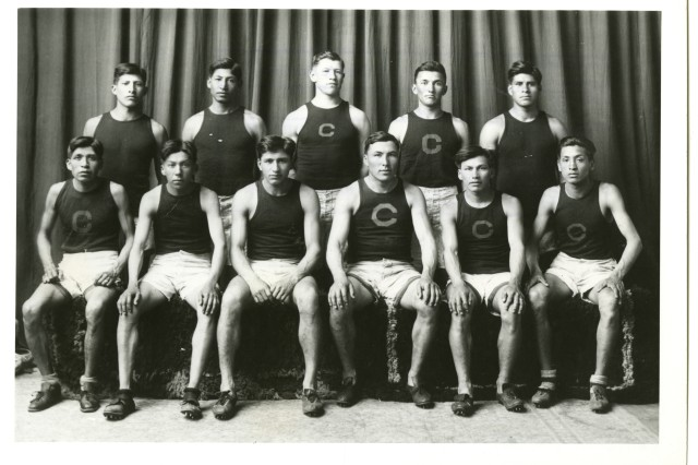 Football Stars: The 1912 Carlisle Indian Industrial School track team. Jim Thorpe is in the center of the back row. (Carlisle Indian Industrial School Photograph Collection)