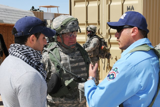 Col. Edward Vaughn, team leader of an Army Human Terrain Team, interacts with the police chief of Abar Layla, a simulated village at the U.S. Army National Training Center at Fort Irwin, Calif., to further develop his interview and rapport building skills prior to his deployment to Iraq later this year.