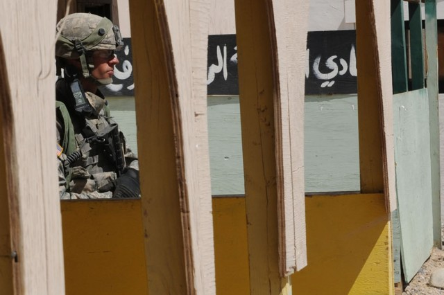 A Soldier from Ironhawk Troop, 3rd Squadron, 3rd Armored Cavalry Regiment, pulls security in the marketplace of Abar Layla, a simulated village situated on the outskirts of the Joint Security Station Abar Layla, as part of the unit's training at the U.S. Army National Training Center at Fort Irwin, Calif., May 28. The 3rd ACR will deploy to Iraq later this year. (Army photo by Jennifer Spradlin, 16th Mobile Public Affairs Detachment)