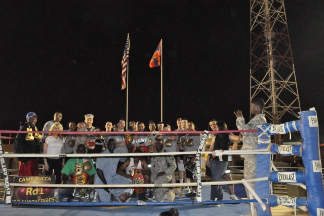 """The fighters and main supporters of the """"Final Chapter"""" of Bucca Boxing pose one last time for a picture in the ring May 15, 2010.  The ring will be transported to Camp Victory later this summer."""