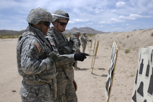 FORT IRWIN, Calif.-A Soldier with the 11th Armored Cavalry Regiment and a Range Safety NCO, count up his targets to verify the shooter's score during an M4 qualification range at Fort Irwin, Calif. May 13. (Photo by Sgt. Giancarlo Casem, 11th ACR Public Affairs)