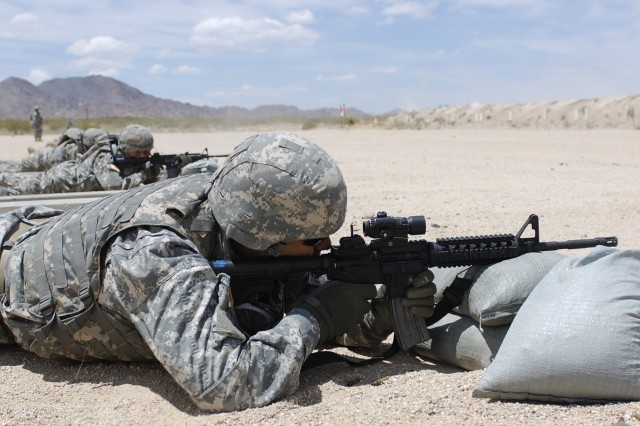 FORT IRWIN, Calif.-Soldiers from the 11th Armored Cavalry Regiment take aim at targets during an M4 carbine weapon qualification range on Fort Irwin, Calif., May 13. (Photo by Sgt. Giancarlo Casem, 11th ACR Public Affairs)