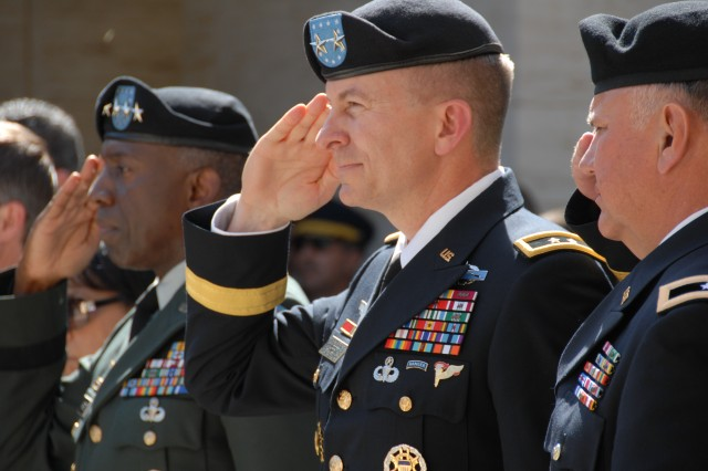 Senior U.S. Army leaders salutes during a May 31 ceremony to mark Memorial Day at the North Africa American Cemetery and Memorial near Carthage, Tunisia. Pictured from left to right are: Gen. William Ward, commander of U.S. Africa Command, Maj. Gen. William B. Garrett III, commander of U.S. Army Africa and Brig. Gen. Isaac Osbourne, deputy commander of U.S. Army Africa.
