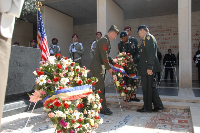 U.S. Army Col. Warren P. Gunderman, a military representative at the U.S. Embassy in Tunis, lays a wreath Monday during a Memorial Day service at the North Africa American Cemetery and Memorial near Carthage, Tunisia.