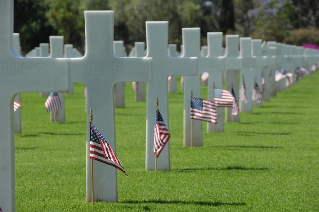 At the North Africa American Cemetery and Memorial near Carthage, Tunisia, white headstones marks the final resting places of more than 2,000 U.S. service members killed in North Africa during World War II.