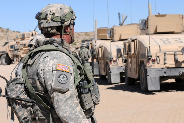 State College, Pa., native Sgt. John Redmond, a cavalry scout with Headquarters and Headquarters Troop, 3rd Squadron, 3rd Armored Cavalry Regiment, watches a line of Humvees May 28 before escorting the commander of 3-3 ACR, as part of the commander's personal security detachment during a four-week training exercise at the National Training Center May 15 through June 8. (U.S. Army photo by Sgt Roger RyDell Daniels, 16th Mobile Public Affairs Detachment)