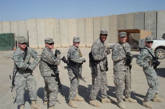 Pfc. Bradley Thompson, of Clermont, Fla.; Pvt. Michael Clark, of Long Beach, Calif.; Spc. Rose Huerta, of Woodland, Ala.; 1st Lt. Randy Chambers, from the District of Columbia; 2nd Lt. Todd Geszvain, of Burlington, Wis.; and Spc. Heather White, of Littleton, Colo.; all assigned to the 3rd Special Troops Battalion, 3rd Brigade Combat Team, 4th Infantry Division, show off their combat patches May 7, 2010.