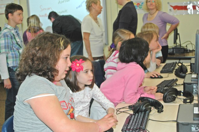 Trebur German elementary school student Aleyna Gumus (left) and Hainerberg Elementary School second-grader Amelia Bettencourt work together to complete a German-English computer game.