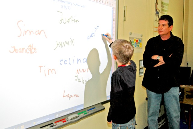 Hainerberg Elementary School's educational technologist, Scott Barlow, gives German students from Trebur a few pointers on how to use a Smart Board during a German-American exchange day May 18.