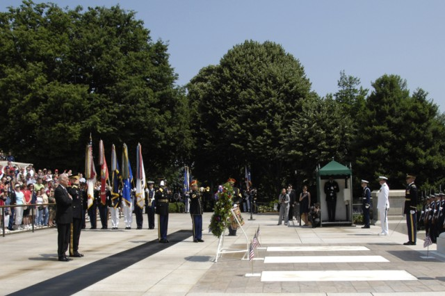 Vice President Joe Biden and Maj. Gen. Karl R. Horst, commander of Joint Force Headquarters-National Capital Region and the U.S. Army Military District of Washington, render honors during the playing of Taps after the wreath is placed at the Tomb of the Unknowns on Memorial Day, May 31.