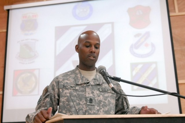"""During the 3rd Heavy Brigade Combat Team, 3rd Infantry Division's Memorial Day observance ceremony May 31, 2010 at Contingency Operating Site Kalsu, Iraq, 1st Sgt. Demetrius Brown, Headquarters Company, 203rd Brigade Support Battalion, reads the names of 3rd HBCT Soldiers lost during Operation Iraqi Freedom. . Since the start of OIF, 79 """"Sledgehammer"""" Soldiers have given their lives in support of that mission."""