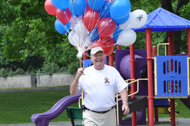 Ed McCarthy, Watervliet Arsenal Deputy Commander, demonstrates that there are no jobs too small when it came to supporting the Arsenal Family Day.  Unlike the movie, Up, McCarthy managed to keep both feet on the ground.
