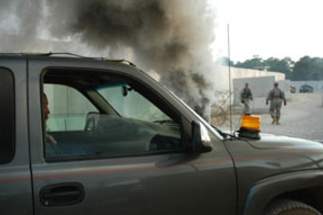 A vehicle smokes after being used as a vehicle-borne improvised explosive device at the Joint Readiness Training Center May 21.