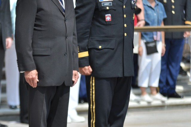 Vice President Joe Biden and Maj. Gen. Karl R. Horst prepare to lay the wreath at the Tomb of the Unknowns at Arlington National Cemetery.