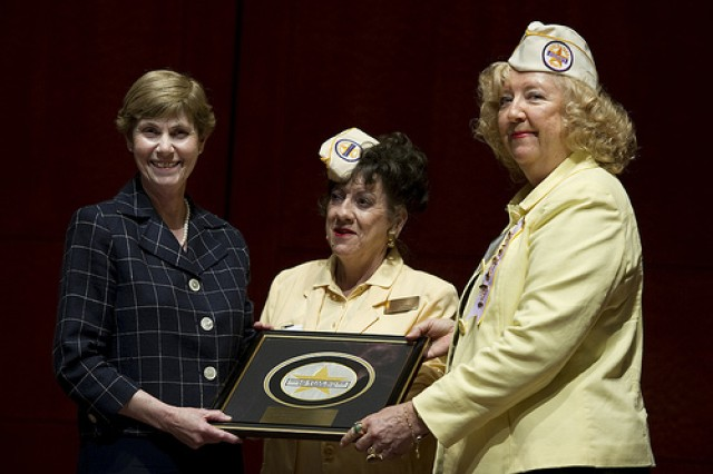 Deborah Mullen (left) is presented the Gold Star Wives of America Appreciation Award by Ruth Miller, board chair, and Kit Frazer, president, Gold Star Wives, at the organization's annual Congressional Reception at the U.S. Captiol Visitors Center May 27. Mullen and her husband, Adm. Mike Mullen, chairman of the Joint Chiefs of Staff, were both honored in recognition of their devotion to families of the fallen and wounded warriors.