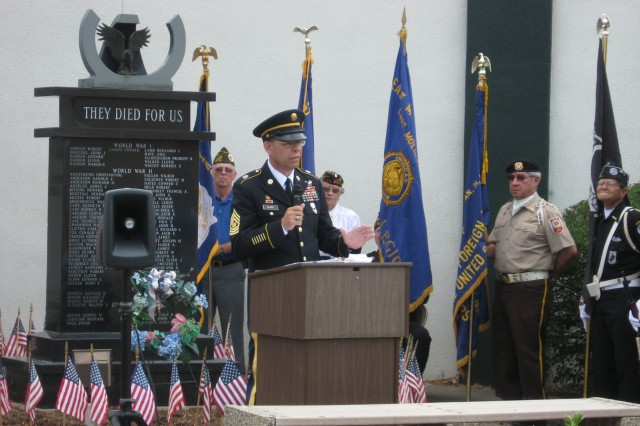 Command Sgt. Maj. Stephen D. Blake addresses the audience at the East Moline Commons Memorial Day ceremony, May 31.  In his remarks, Blake stressed the need for Americans to honor those who fought and died to defend our Nation's freedom. (Photo by Dan Carlson, ASC Public Affairs)