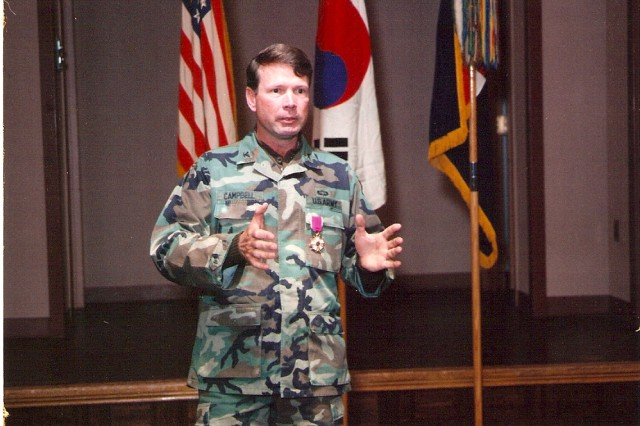 Then Col. Charles C. Campbell speaks as the commander of a heavy brigade in 2nd Infantry Division in the Republic of Korea. He served several tours in the Republic of Korea during his 40-year career, his most recent one as the commanding general of Eighth Army.