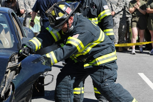 PRESIDIO OF MONTEREY, Calif. - Presidio of Monterey firefighters tear through vehicles using various victim-extraction equipment in what was, arguably, the most popular event during Safety Day May 28.