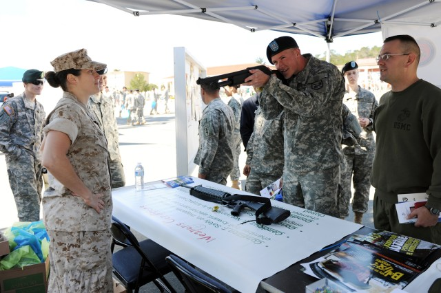 PRESIDIO OF MONTEREY, Calif. - Presidio of Monterey Marine Detachment members were on hand with a Safety Day station featuring firearm safety May 28. Safety Day is an annual event aimed at teaching the Presidio of Monterey community about various ways to stay safe on or off the installation.
