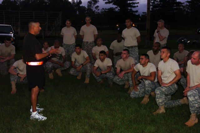 Command Sgt. Maj. Frank M. Leota, command sgt. maj., 25th Infantry Division, speaks to the division's candidates for the Sgt. Audie Murphy Club prior to a long day of qualification events May 25 at Schofield Barracks, Hawaii.  The Soldiers did pushup and situps in the Army Combat Uniform (minus blouse and headgear), an 8-mile ruck march with full battle gear, weapons qualification, six common task training lanes, and six round-robin board appearances before individual board members. (U.S. Army photo by Staff Sgt. Tim Meyer, 25th Inf. Div. Public Affairs.)