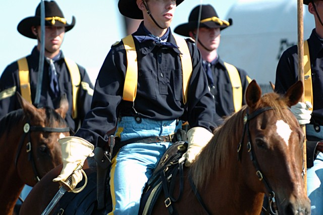 FORT HOOD, Texas-Capt. David Jackson, of Jacksonville, Texas, takes the reins, literally, of the 1st Cavalry Division's Horse Cavarly Detachment, here, May 27. Jackson takes over command from Capt. Jay Bunte.
