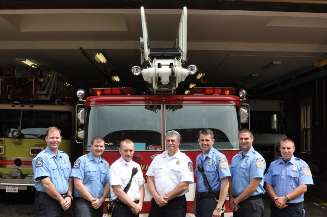 """For 190 years, Arsenal firefighters have proudly protected the workforce, equipment, and buildings. Today's firefighter must be certified in two levels of Department of Defense firefighting, certified in Hazardous Materials Operations, and certified as an Emergency Medical Technician.""""  From left, firefighters Donald Haberski, Matthew Kolodzie, Assistant Chief Kenneth Haviland, Chief Kim Polcare, Captain Steve Mair, and Timothy Cuilla."""