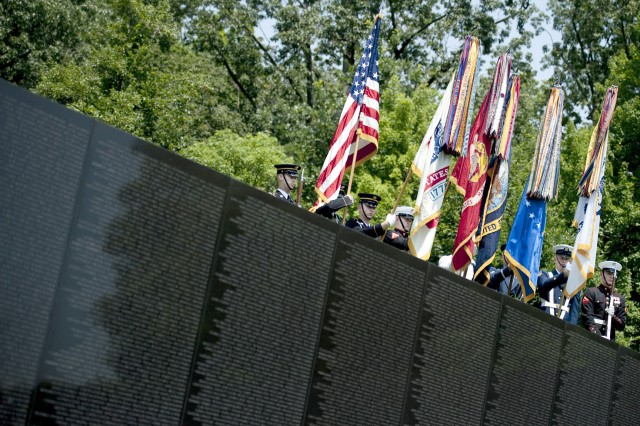 The Joint Service Color Guard presents the colors at the Vietnam Veterans Memorial in Washington, D.C., on May 31, 2010, during the annual Memorial Day observance.