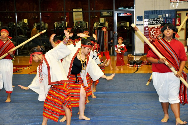 "FORT HOOD, Texas-Dancers with the Filipino-American Association performs a traditional dance called ""Binasuan"" during the Asian/Pacific-Islander Heritage Month, here, May 27. During the dance the performers will take two steps forward then one step back."
