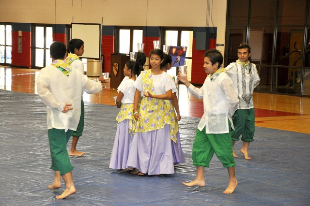 """FORT HOOD, Texas-Dancers from the Filipino-American Association perform the dance """"Pandango Sa Ilaw"""" at the Asian/Pacific-Islander Heritage Month observance, here, May 27. The dance symbolizes the wives of the fishermen lighting their husbands paths home from the fishing with tea-light candles."""