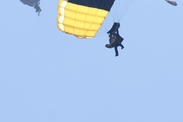 Soldiers from 7th Signal Command (Theater) and Fort Gordon, Ga. mark the Signal Corp\'s 150th Anniversary by making tandem jumps with the Golden Knights at Laurinburg-Maxton Airport, N.C. recently.