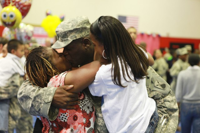 MANNHEIM, Germany (May 30, 2010) -- Command Sergeant Major Terence Farmer hugs his family during the 7th Theater Tactical Signal Brigade's welcome home ceremony held at the Sullivan Gym on Sullivan Barracks. Farmer was one of over 50 Soldiers who returned from a 12 month-long deployment in support of Operation Enduring Freedom, where their unit established and operated a central Theater Communications Center. (Photo by Jonathon M. Gray, 5th Signal Command)(released)