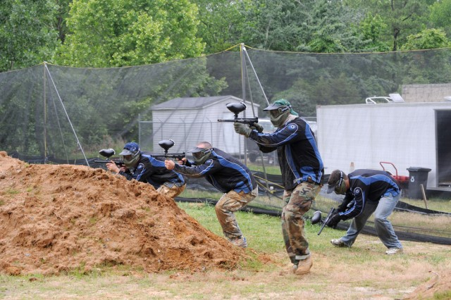 Soldiers from the Combined Arms Support Command\'s legal team have a day of team building at Fort Lee's new paintball facility.