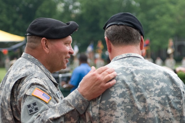 Gen. James D. Thurman talks with Gen. Charles C. Campbell, at the US Army Forces Command change of command ceremony at Ft. McPherson, GA, June 3, 2010.