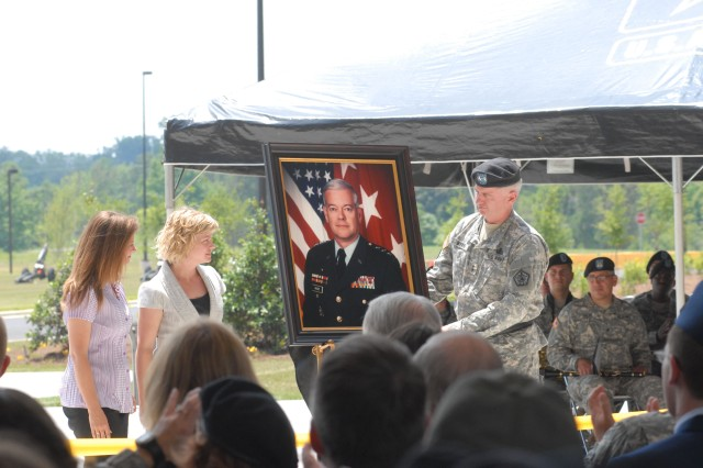 Lt. Gen. Timothy Maude's daughters, Kathleen Koehler and Karen Maude, viewed their father's portrait at the building dedication ceremony.