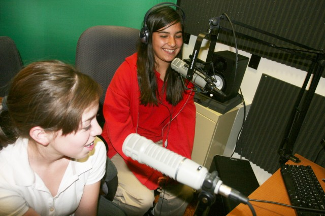 "Sophia Monge, 14 (left), and Julianna Diaz, 13, prepare for their new radio show on Huachuca Wired. The duo, who are youth from Fort Huachuca's teen center, will host a radio spot consisting of upbeat music they say ""you can