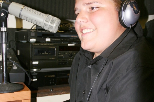 Tyler Scarborough, 14, works on a radio spot during a dry-run for